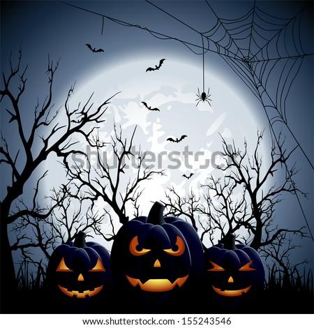 three halloween pumpkins on