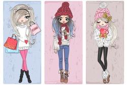 Three hand drawn beautiful cute winter girls. Vector illustration.