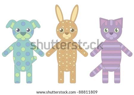 three handmade toys from socks: a dog, cat and rabbit