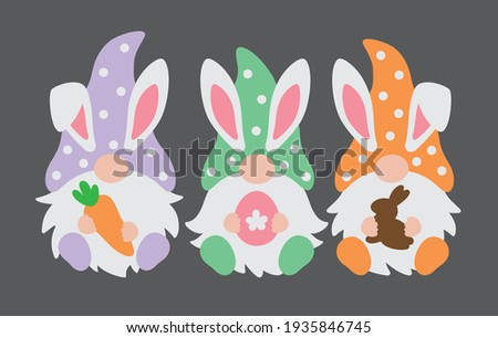 Three happy Easter gnomes with bunny rabbit ears holding a carrot, Easter egg, and chocolate bunny vector illustration.  Stock fotó ©