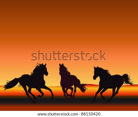three horses gallop silhouetted