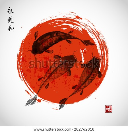 three koi carps and red sun