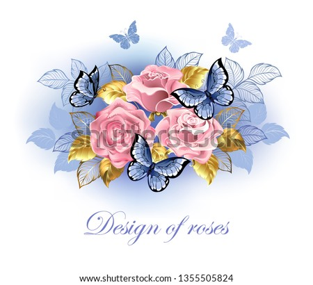 three pink roses with blue and