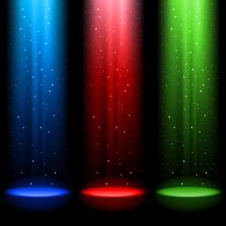 Three RGB shafts of light shines a spotlight into the black