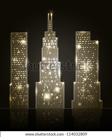 three skyscrapers shining in