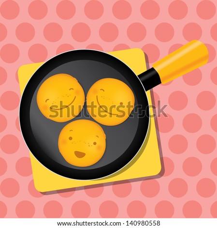 three smiling mini pancakes on