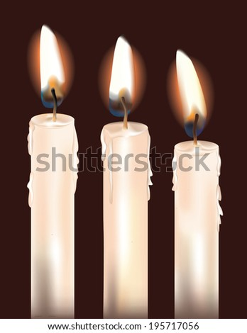 three white candles isolated on