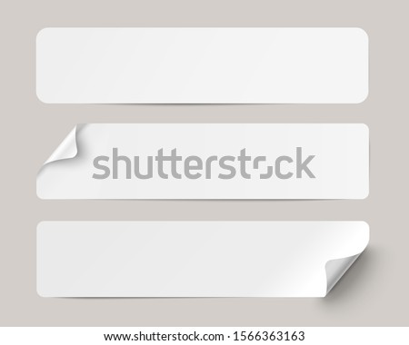 Three white realistic paper adhesive stickers with curved corner on transparent background.