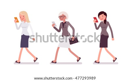 three women are walking holding