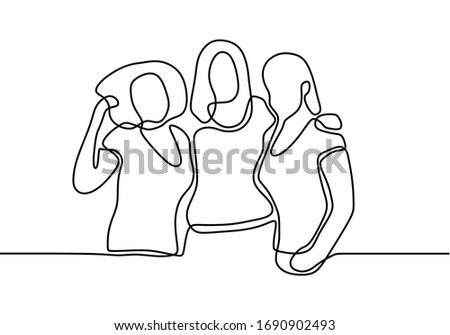 three women embrace each other