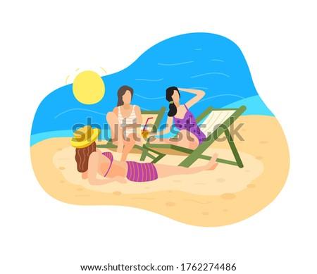 three women relax and sunbathe