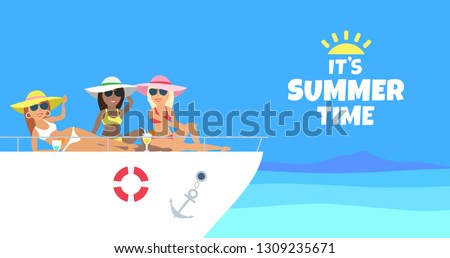three women relaxing on yacht