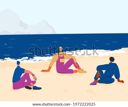 three young women sitting on