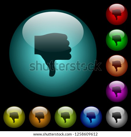 Thumbs down icons in color illuminated spherical glass buttons on black background. Can be used to black or dark templates