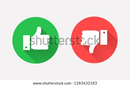 Thumbs up and down flat icons. Hands showing Like and Dislike signs. Modern circle symbols with long shadows for social media or apps. Vector illustration.