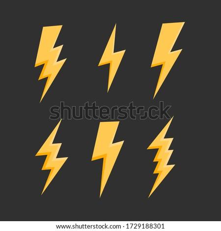 Thunderbolts icons set. Lightning bolt icons isolated on black background. Lightning strike flat icons. Vector illustration