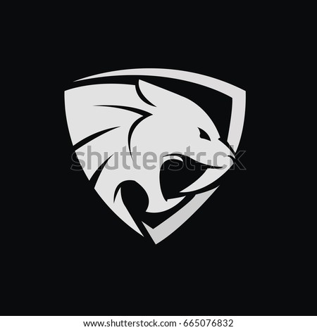 Stock Photo tiger / saber vector design within a shield in vector format.