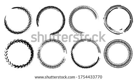 Tire track circle grunge frame. Digital vector illustration. Automotive background elements set for poster, print, flyer, booklet, brochure and leaflet design. Editable image in monochrome colors. Stockfoto ©