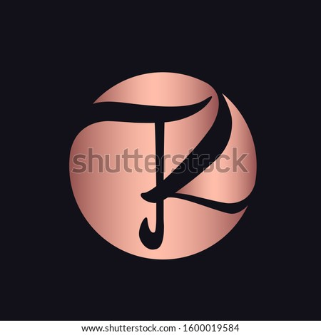 TK monogram logo.Circular emblem style typographic icon.Lettering sign alphabet initials in rose gold color isolated on dark background.Intertwined script letter t and letter k.Calligraphy characters