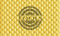 Tools gold emblem or badge. Scales pattern. Vector Illustration. Detailed.