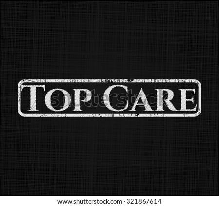 Top Care chalkboard emblem on black board