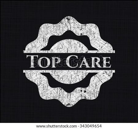 Top Care chalkboard emblem written on a blackboard