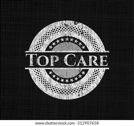 Top Care written on a blackboard