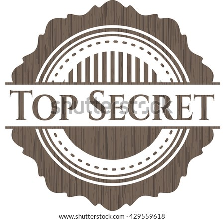 Top Secret badge with wood background