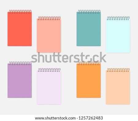 Top spiral A4 notebook with colored cover and sheets, mockup set. Wire bound blank multicolored notepads, mock-up. Sketchbook or diary, vector template.