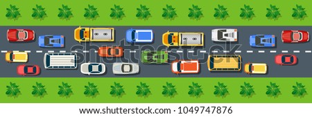 Top view from above on a city street with cars, trees, bus
