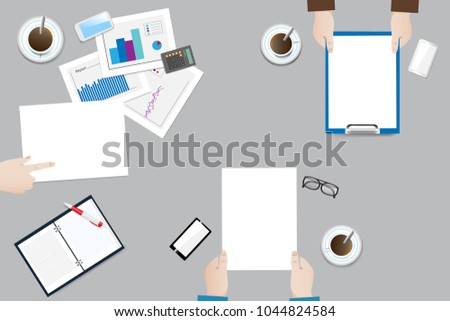 Top view of the office desk with office equipment. Business meeting leads a woman, subordinates have blank papers ready for text.