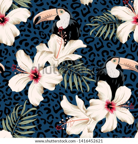 Toucans, hibiscus flowers, palm leaves, leopard skin texture navy background. Vector floral seamless pattern. Tropical illustration. Exotic plants, birds. Summer beach design. Paradise nature