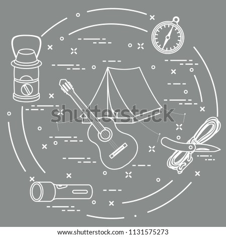 Tourism and outdoor recreation. Tourist tent, guitar, flashlight, rope, knife, compass, lamp. - Shutterstock ID 1131575273