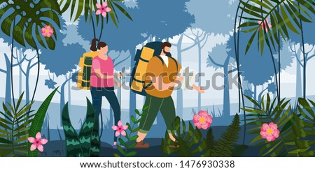 Tourists cute couple with map and backpacks performing outdoor touristic activity. Forest trees mountain landscape. Adventure travel, hiking walking trip tourism wild nature trekking. Pair of tourists