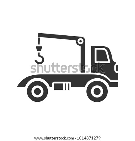 Tow truck glyph icon. Evacuator. Car wrecker. Silhouette symbol. Negative space. Vector isolated illustration