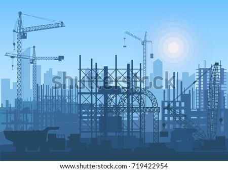 Tower cranes on construction site. Buildings under construction.