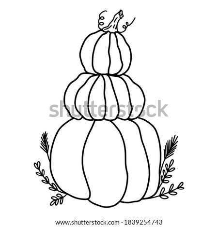 tower of pumpkins in the grass