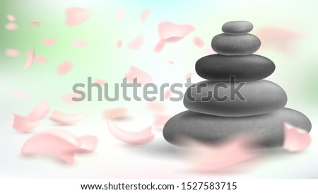 Tower of stones and pink petals, massage and spa, oriental medicine, harmony and meditation