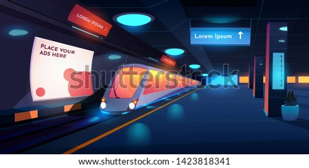 train in metro station at night