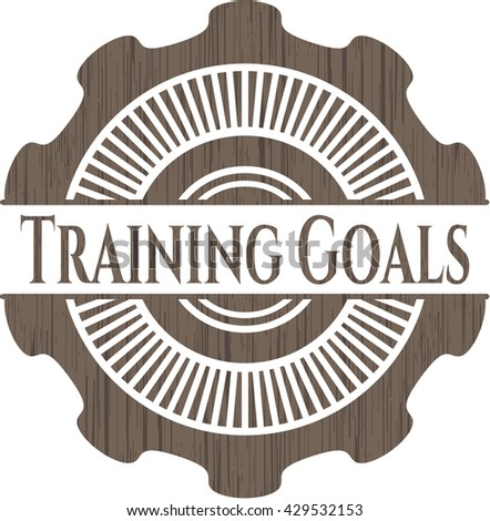 Training Goals badge with wooden background