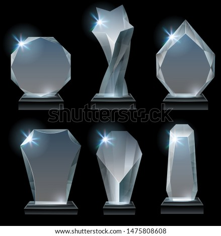 Transparent trophy awards. Glass award on stand, acrylic awards trophies and clear winner crystal realistic sign. Achievement prizes, sport victory trophy. Isolated vector icons set