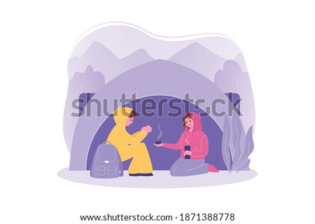 Travelling couple, hiking, tourism, camping concept. Couple in love man woman boyfriend girlfriend travelers hikers hide in camp from cold drink tea. Vacation trip with active lifestyle and recreation