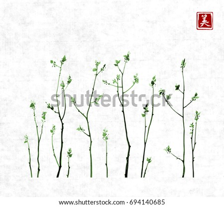 Tree branches with fresh green leaves on rice paper background. Traditional oriental ink painting sumi-e, u-sin, go-hua. Contains hieroglyph - beauty.