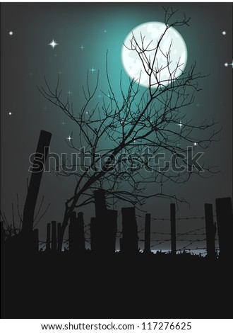 Tree silhouette against fence with barbed wire - lunar landscape