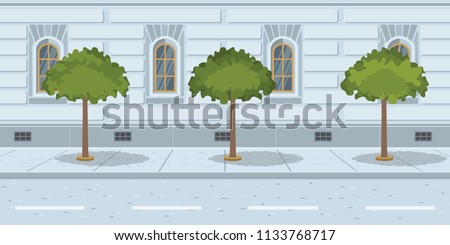 trees in line on urban street