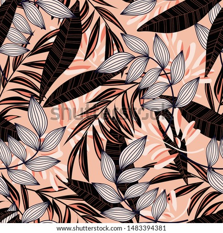 Trending abstract seamless pattern with colorful tropical leaves and plants on pink background. Vector design. Jungle print. Floral background. Printing and textiles. Exotic tropics. Summer.