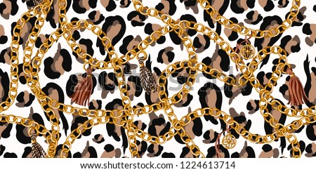 Trendy seamless pattern with gold chains on leopard skin.
