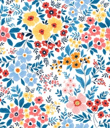 Trendy seamless vector floral pattern. Seamless print made of small multicolored flowers and blue leaves . Summer and spring motifs. White background. Vector illustration.