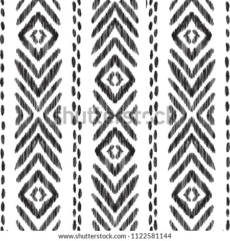 Tribal seamless pattern. Black and white vector illustration. Ethnic ornament in the Aztec, Navajo and American Indian style. Can be used for textile, background, wallpaper or wrapping paper.