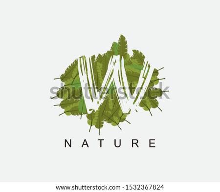 Tropical Banana Leaf Vector Logo Letter W. W Letter Design Vector Green Banana Leaf Logo Icon. Zdjęcia stock ©